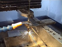 EDM small hole drilling and EDM services on a current hole burning machine, at MILCO Wire EDM