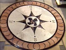Architectural pendant floor display, abrasive waterjet cut out of granite and other assorted natural materials, from MILCO Waterjet