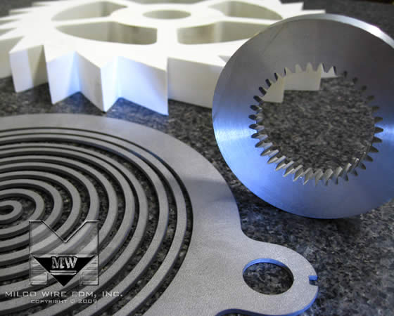 Stainless steel, plastic and aluminum sample prototype parts cut with abrasive waterjet machining, from MILCO Waterjet